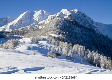 Beautiful alpine scenery with snow and hut