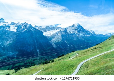 Beautiful Alps Mountain with blue sky in Grindelwald, Switzerland