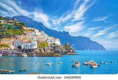 Beautiful Amalfi on hills leading down to coast, comfortable beaches and azure sea in Campania, Italy. Amalfi is most popular travel and holyday destination in Europe.