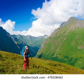 Beautiful amazing day summer mountains. A woman goes a sport hike in holidays. Nature background. Northern country Russia Caucasus wilderness. Inspiring leisure. Green forest