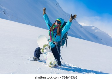Beautiful amazing day winter mountains in Switzerland. A woman rides snowboard. Sport hike holidays. Landscape inspiring. Cool fun girl. Blue sky and white snow. Happy hobby in Zermatt.