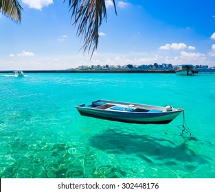 Beautiful amazing nature background. Boat in tropical blue sun sea. Luxury holiday resort. Island atoll about coral reef. Fresh  freedom. Adventure day. Snorkeling. Coconuts  unique