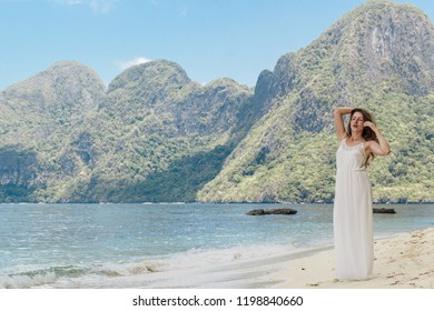 Beautiful amazing nature background. Tropical blue sun sea in Philippines . Luxury holiday resort. Island coral reef. Fresh freedom. Adventure day. Coconut paradise. Woman has long dress