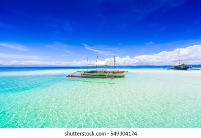 Beautiful amazing nature background. Tropical blue sun sea in Philippines. Luxury holiday resort. Island atoll about coral reef. Fresh freedom. Adventure day. Snorkel. Coconut paradise. Wooden boat.