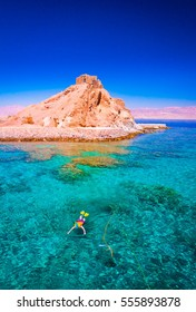 Beautiful amazing nature background. Tropical blue water. Red sea. Holiday resort. Island coral reef. Fresh  freedom. Adventure day. Luxury paradise. Inspiring wilderness. People snorkeling