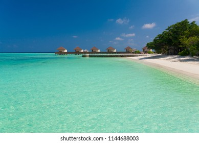 Beautiful amazing nature landscape. Tropical blue Maldives sea. Luxury holiday resort. Island atoll and coral reef. Travel eco paradise. Great panorama view. Inspiring bungalow in summer.