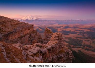 Beautiful amazing sunset landscape.  Mountain Elbrus in Bermamyt plateau. Caucasus in Russia country.Autumn view nature. Inspiring travel panorama. Unique scenery.