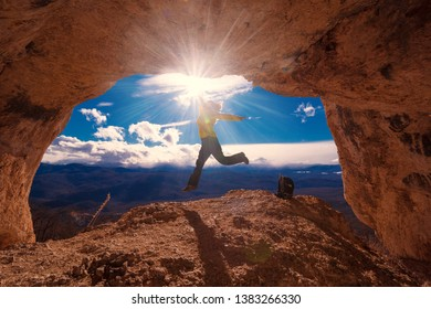 Beautiful amazing sunset.  Mountains in north country Russia Caucasus. Unique landscape mainsail.  Jumping travel woman. Old nature cave. Active sport hobby. Spelunking quest panorama.