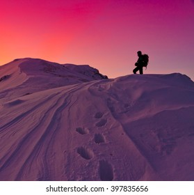 Beautiful amazing sunset winter mountains. A man goes a sport hike in snow holidays. Nature background. Unique landscape. Northern country Russia Caucasus. Go to the aim.  Quest