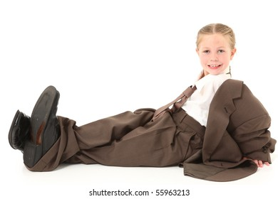 Beautiful  american four year old girl dressed in oversized business suit.