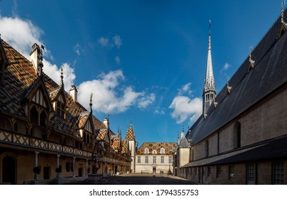 Beautiful ancient architecture of Burgundy. Streets of the city of Beaune. Sunny spring day. Advertising tourist types. France.