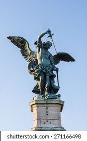 Beautiful ancient bronze statue of Michael the Archangel, standing on top of the Castle of the Holy Angel (Castel Sant'Angelo). Rome, Italy