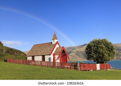 Beautiful ancient Maori church under the rainbow in Akaroa, New Zealand