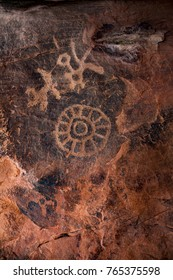 Beautiful ancient petroglyphs carved into a red rock