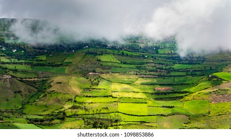 Beautiful andean highland landscape with terraces and fog , Ecuador