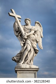 Beautiful Angel sculpture in Rome with an incredible dramatic cloudy sky on the background