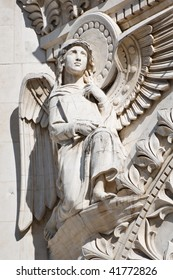 Beautiful Angel Sculpture with Wings and Holy Bible.