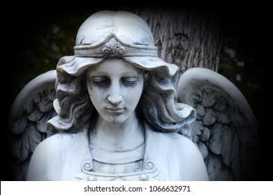 A beautiful Angel watching over God's creation set in a stone statue.