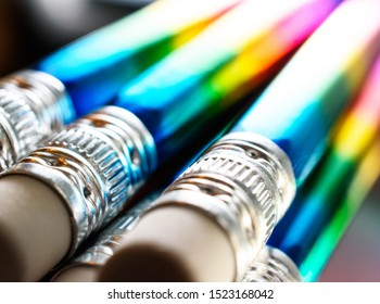 Beautiful Angled Closeup of Aluminum and White Erasers Ends of Foiled Rainbow Pencils