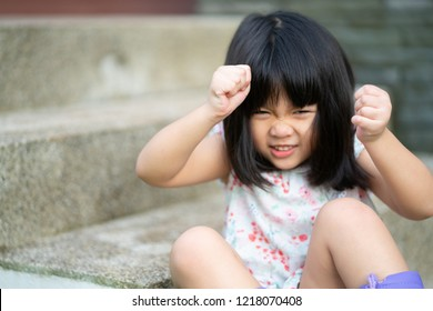 Beautiful angry little girl looking at camera.Mad kid got upset and sad and she has a negative attitude.Depressed little girl complaining.Attention deficit hyperactivity disorder (ADHD) Concept