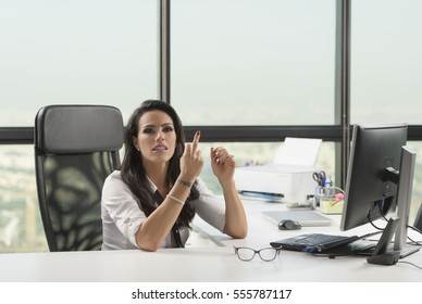 858baaa4cff Beautiful angry secretary at desk giving the finger with eye wear glasses  on table