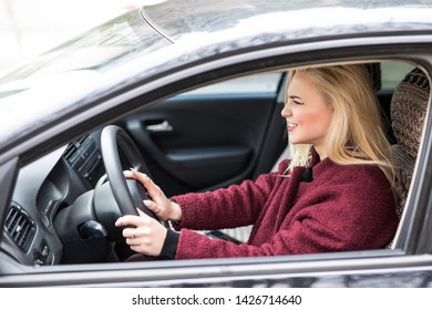 Beautiful angry woman honking in her car while driving