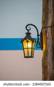 Beautiful antique lanterns on the wall.