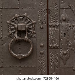 beautiful antique metal door with a handle and a lock, very strong and reliable