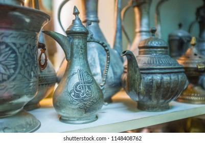 The beautiful antique tea and coffee pots, decorated with chasing in stall of Old Bazaar, Antalya, Turkey.
