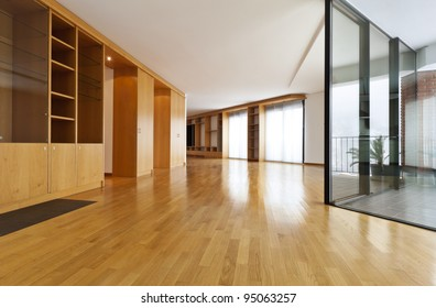 beautiful apartment, interior, empty room with windows and wall cabinet