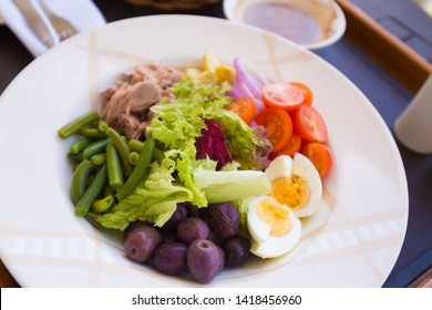 Beautiful appetizer Nicoise salad, has tuna fish and vegetables. Luxury food background. Close up.