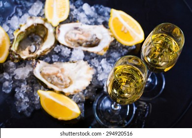 beautiful appetizer oysters and alcohol two glasses wine champagne luxury life background studio food