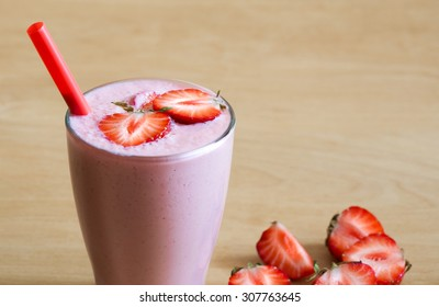 Beautiful appetizer strawberry fruit smoothie. Pink yogurt cocktail. Close up. Natural detox. Rustic style