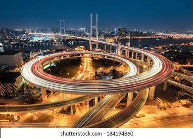beautiful approach bridge of shanghai nanpu at night ,spiral in a complex curve
