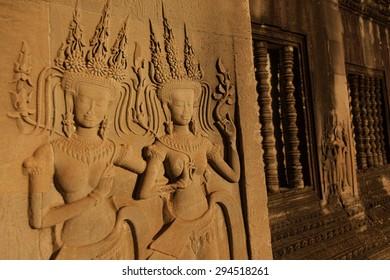 Beautiful Apsara carving in the morning light at Angkor Wat Siem Reap Cambodia