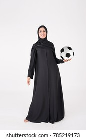 beautiful arab girl holding and playing with soccer ball on white background