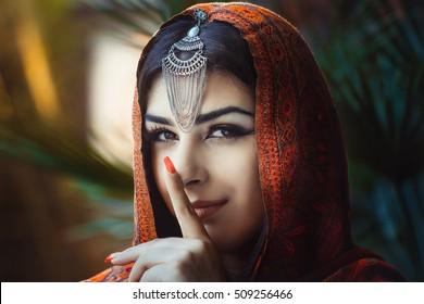 Beautiful arab saudi woman wearing traditional dress and a read veil
