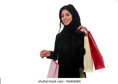 Beautiful arab traditional woman holding shopping bags