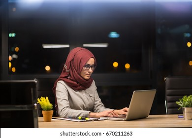 Beautiful Arab woman with hijab working overtime. Stressed life of nowdays moms.