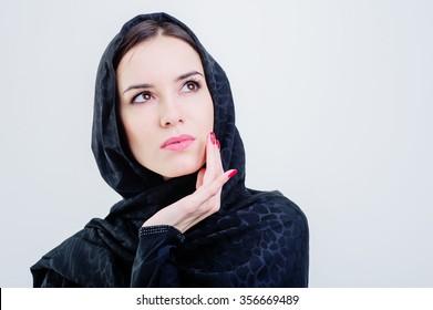 Beautiful arab woman looking forward isolated on grey background.