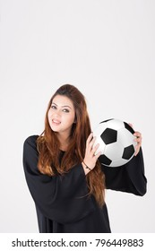 Beautiful Arab woman in traditional dress carrying soccer ball on white background