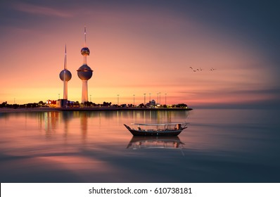 beautiful arabian boat in in front of kuwait tower during sunset