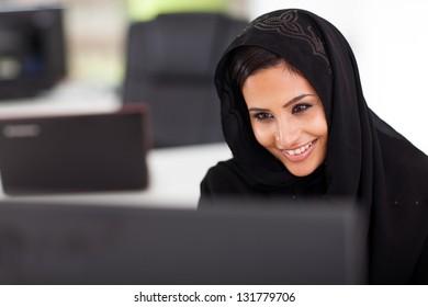 beautiful Arabian businesswoman working on computer in office