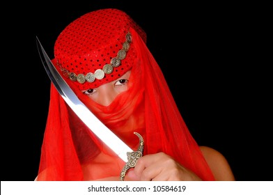Beautiful arabian style dancer with red veil and sword