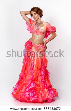 684bdb30f914 Beautiful Arabic belly dancer harem woman plus size in orange dress and  jewelry dancing arms in air, isolated. Sexy oriental bellydance woman in  traditional ...