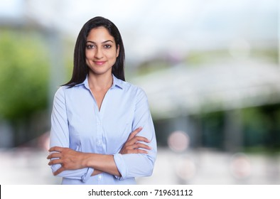 Beautiful arabic businesswoman with crossed arms