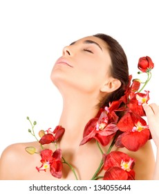 Beautiful arabic woman with closed eyes and red orchid flowers isolated on white background, enjoying dayspa, beauty salon