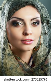 Beautiful Arabic woman wearing head scarf