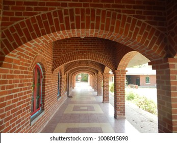 A beautiful arched beam's corridor in brick constructed architecture