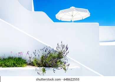 Beautiful Architecture building Exterior with santorini and greece style. Modern white design apartment in Oia village on Santorini island, Cyclades, Greece.